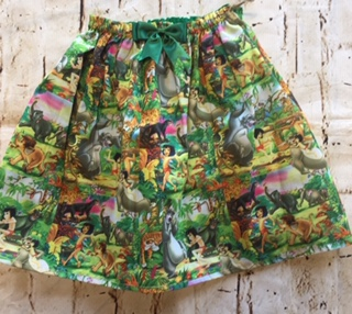 Elasticated Skirt (6-7 years) in Polly cotton Jungle Book design with 8cm green bow