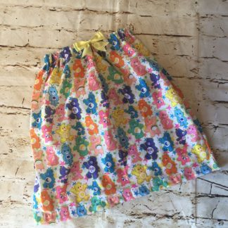 Elasticated skirt (6-7 years), in Polly cotton fabric with Carebear design with an 8cm yellow bow