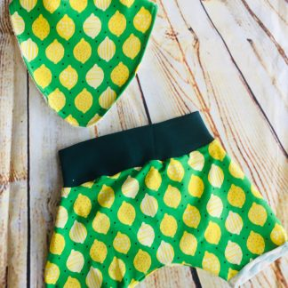 Harems Shorts & Bib Set (6-12 months) in Green jersey fabric with yellow lemon design with dark green ribbing & rolled hems