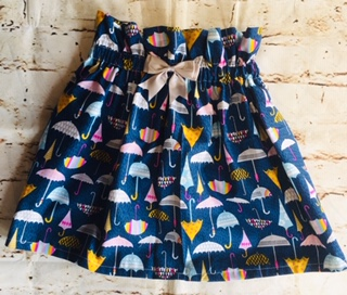 High Waisted Elasticated Skirt (3-4 years) in Blue cotton fabric with umbrella design, with a 8cm grey bow