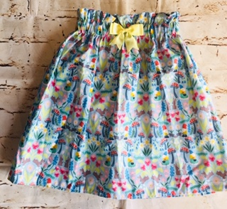 High Waisted Elasticated Skirt (5-6 years) in Light blue cotton fabric with Gnomes, rabbits & toadstools design, with a 8cm yellow bow