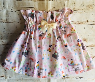 High Waisted Elasticated Skirt (5-6 years) in Light pink cotton fabric with Gnomes & bunnies design with a 8cm cream bow