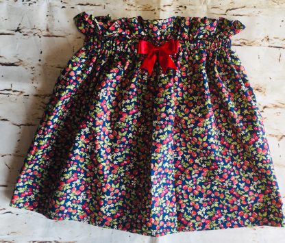 High Waisted Elasticated Skirt (6-7 years) in Navy cotton fabric with mini strawberries design, with a 8cm red bow