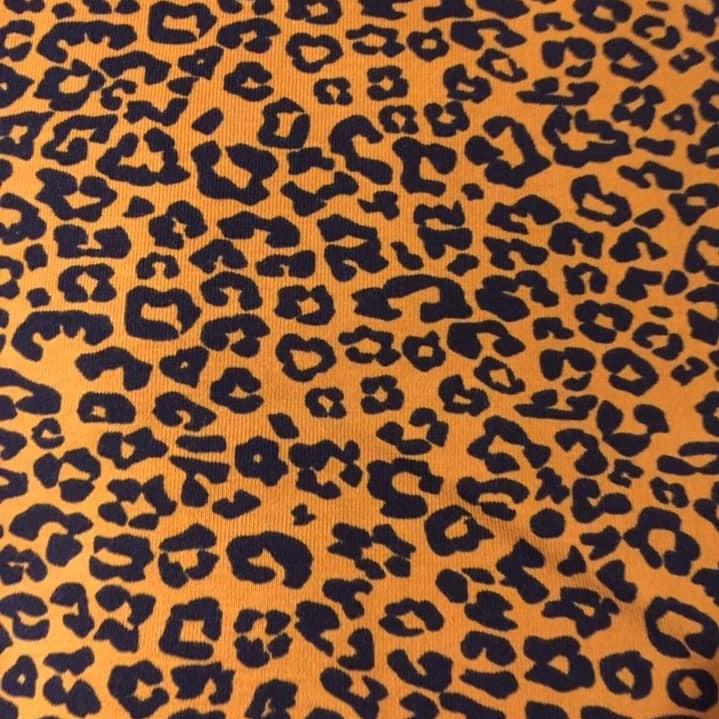 Black Leopard Print Design on Orange Jersey Fabric