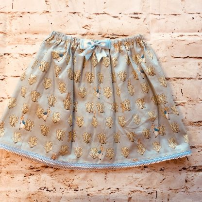 Elasticated Skirt (5-6 years) in cotton fabric with Peter Rabbit design, with a 8cm light blue bow