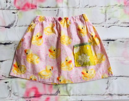 Elasticated Skirt (3-4 Years) in Cotton fabric with yellow duck design, with a pink button & small pocket (vintage flowers)