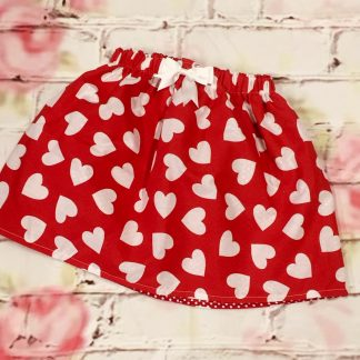 Elasticated Skirt (4-5 years) Polly cotton fabric, red with white heart design, fully lined (spotty fabric) with a 8cm white bow