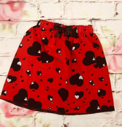 Elasticated Skirt (4-5 years) in Polly cotton red fabric black & white hearts design, fully lined with black & red spotty fabric & 8cm