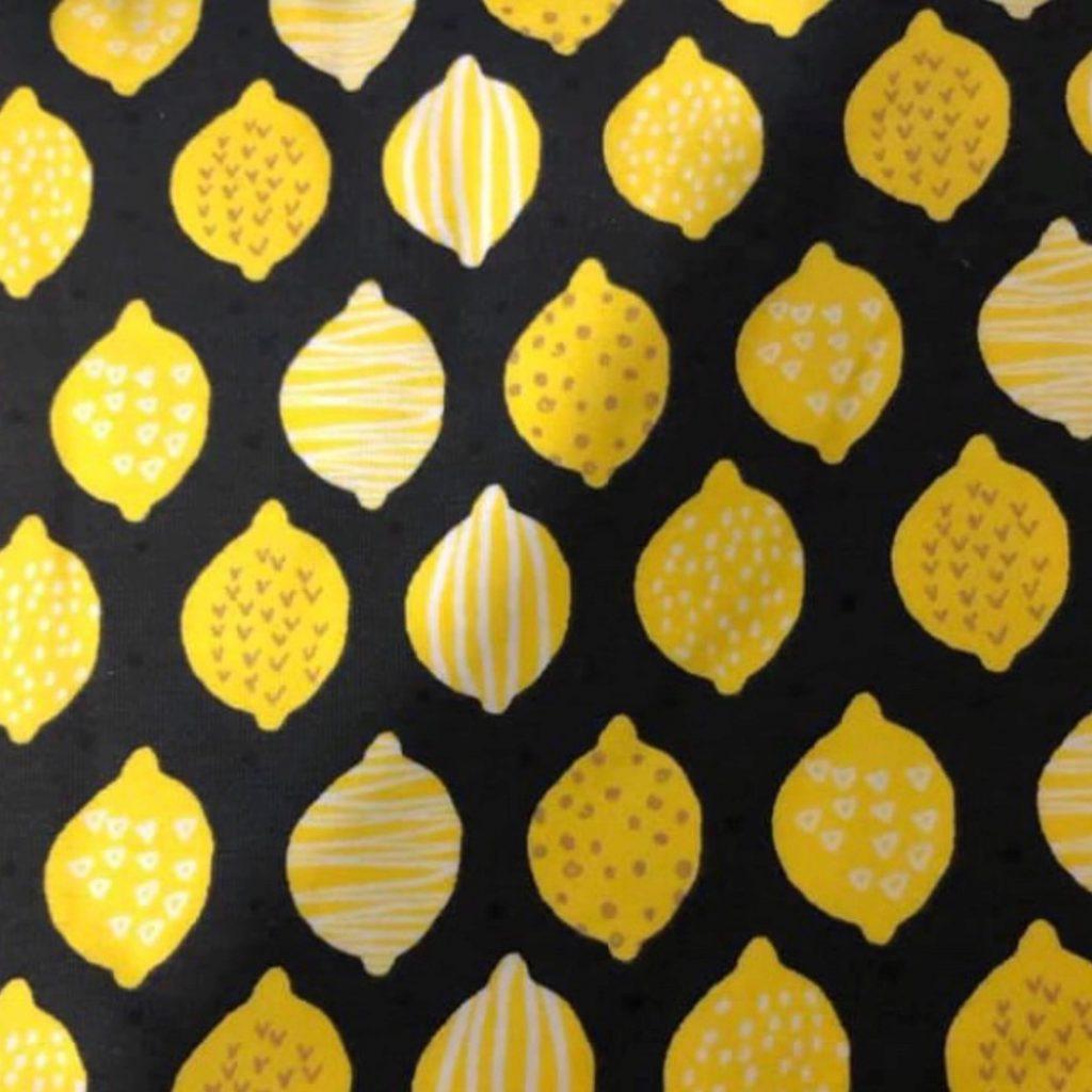 Lemon Variety on Black Jersey Fabric