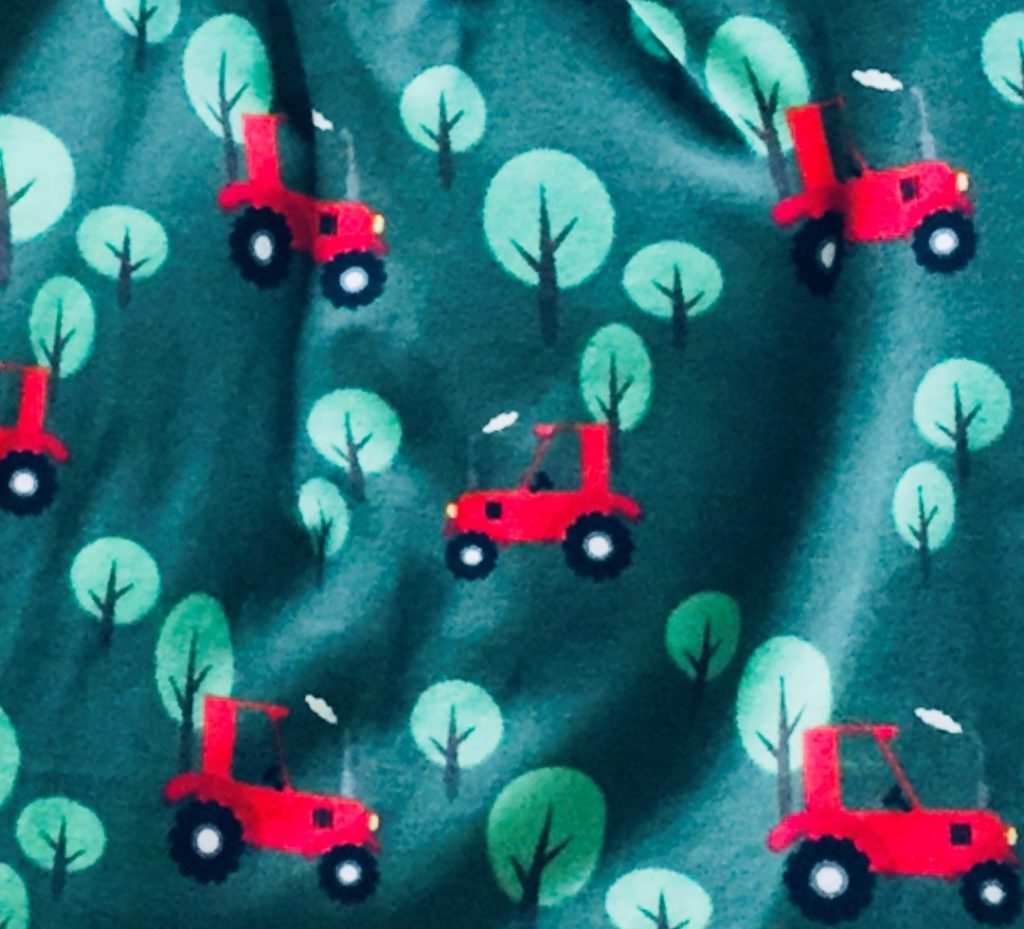 Red Tractors and Light Green Trees on Dark Green Fabric