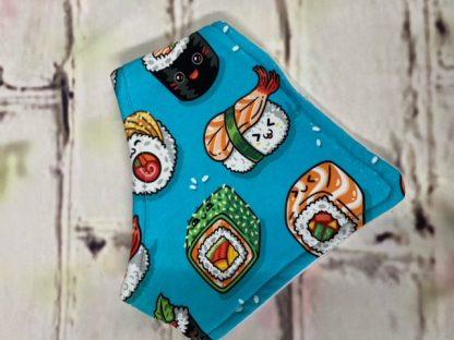 Dribble Bib (Cartoon Sushi on Design on Blue Jersey Fabric)