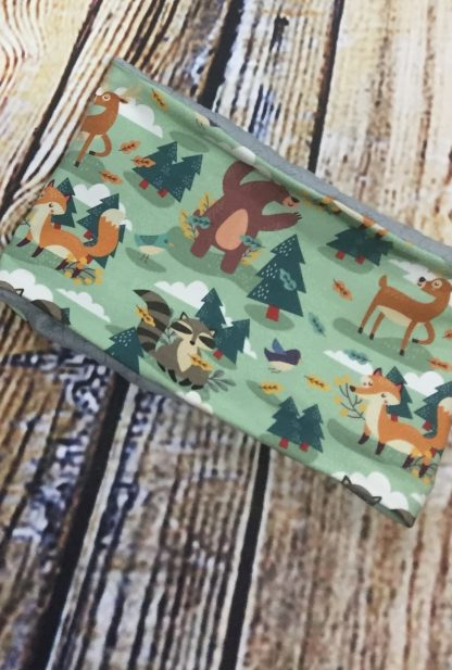 Snood/Neck warmer in dark green jersey fabric with forest animals