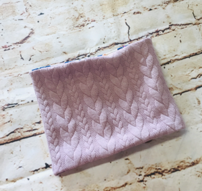 Snood / Neck warmer with pink knit design on jersey fabric